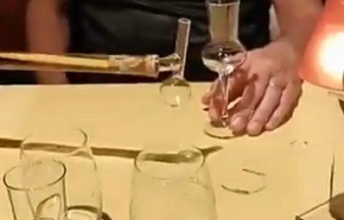 Socijalna distanca uz rakiju: Restoran lansirao NAJDUŽE flaše za borbu sa koronom (VIDEO)