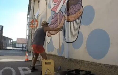 """Zovu ga """"Dobrica"""": Umetnik pronašao sjajan način da ulepša grafite koji pozivaju na nasilje (VIDEO)"""