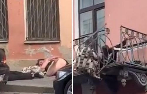 I ograda popustila pod naletom strasti: Žena TUKLA muškarca na terasi, pa POPADALI na ulicu (VIDEO)