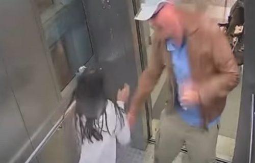 UZNEMIRUJUĆI SNIMAK: Policajac pipao devojčicu u liftu i probao da je poljubi dok se ona opirala (VIDEO)