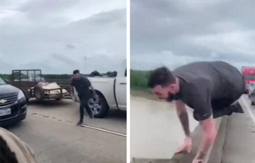 Skočio s mosta da bi izbegao gužvu: Jedva je preživeo udarac i reku punu aligatora (VIDEO)