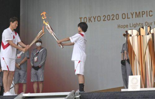 Stigao olimpijski plamen, odmah protesti u Tokiju: Nikad tužnije scene pred početak Igara (FOTO)