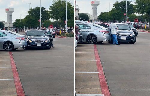 Bizarna scena na parkingu: Telom pokušao da zaštiti kola od udaraca i štete (VIDEO)